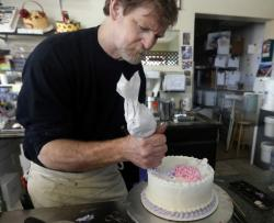 Masterpiece Cakeshop owner Jack Phillips decorates a cake inside his Lakewood, Colo., store on March 10, 2014.
