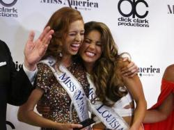 Miss Minnesota Brianna Drevlow, left, and Miss Louisiana Laryssa Bonacquisti, right, meet reporters after winning preliminary competitions