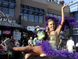 Miss Louisiana 2017 Laryssa Bonacquisti shows the crowd her shoe during a parade on the Atlantic City boardwalk