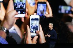 In this Wednesday, Sept. 7, 2016, file photo, Apple CEO Tim Cook announces the new iPhone 7 during an event to announce new products, in San Francisco