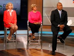 Charlotte Mayor Jennifer Roberts, Mayor Pro Tem Vi Lyles and State Sen. Joel Ford, listen to a moderator during a televised debate.