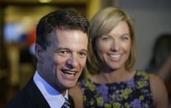 Republican David Trott, a candidate for Michigan's 11th congressional district, stands next to his wife, Kappy, during an interview.