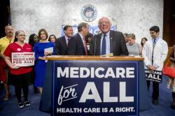 Sen. Bernie Sanders, I-Vt., is joined by Democratic Senators and supporters as he arrives for a news conference on Capitol Hill in Washington, Wednesday, Sept. 13, 2017, to unveil their Medicare for All legislation to reform health care.