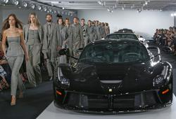 Models walk the runway beside Ralph Lauren's car collection in The Garage at the Ralph Lauren fashion show during Fashion Week.