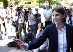 Ana Brnabic, Serbia's prime minister-designate, waves to her supporters in Vrnjacka Banja, Serbia.