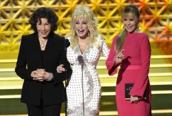 Lily Tomlin, from left, Dolly Parton and Jane Fonda present the award for outstanding supporting actor in a limited series or a movie at the 69th Primetime Emmy Awards.