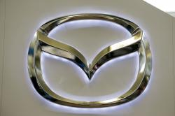 This Feb. 14, 2013, file photo, shows the Mazda logo on a sign at the 2013 Pittsburgh Auto Show, in Pittsburgh.