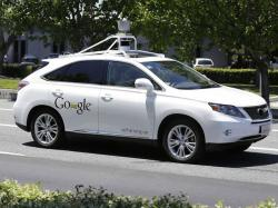 In this May 13, 2015, file photo, Google's self-driving Lexus car drives along street during a demonstration at Google campus in Mountain View, Calif.
