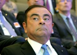 Renault Group CEO Carlos Ghosn attend a media conference at La Defense business district, outside Paris, France, Friday, Oct. 6, 2017