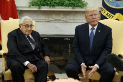 President Donald Trump meets with former Secretary of State Henry Kissinger in the Oval Office of the White House, Tuesday, Oct. 10, 2017, in Washington