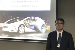 "Toyota Motor Corp. manager Makoto Okabe stands in front of a image of the concept car ""TOYOTA Concept-i"" series Monday Oct. 16, 2017 in Tokyo"
