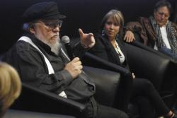 Author and film producer George R. R. Martin, left, speaks in Santa Fe, N.M., Thursday, Oct. 19, 2017