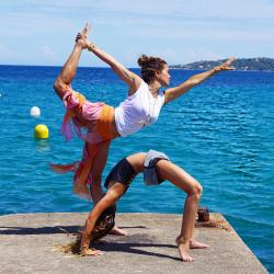 This undated photo provided by Brooke Burke Charvet shows Charvet doing yoga with her daughter Rain in Malibu, Calif.