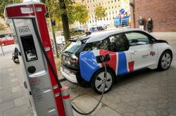 In this Wednesday, Oct. 18, 2017 photo a car is connected to a charging station for electric vehicles in Hamburg, Germany
