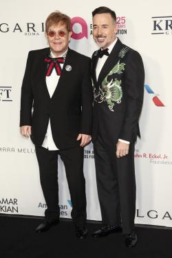Elton John, left, and David Furnish, right, attend the Elton John AIDS Foundation's 25th Anniversary Gala.