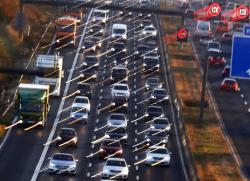 Cars and trucks queue on the highway A5 in Frankfurt, Germany, Monday, Nov. 6, 2017