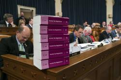 Volumes of tax regulations are stacked on the dais as the House Ways and Means Committee begins the markup process of the GOP's far-reaching tax overhaul, the first major revamp of the tax system in three decades, on Capitol Hill in Washington, Monday, Nov. 6, 2017