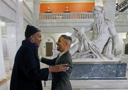 Newly elected city council members Phillipe Cunningham, right, and Andrea Jenkins greet each other prior to an interview Thursday, Nov. 9, 2017, at City Hall in Minneapolis.