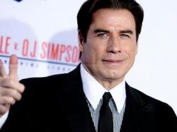 "In this Jan. 27, 2016, file photo, actor John Travolta attends the LA Premiere of ""'American Crime Story: The People v. O.J. Simpson"" held at Westwood Village Theatre in Los Angeles."