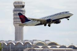 In this July 28, 2014, file photo, a Delta Air Lines jet takes off from Ronald Reagan Washington National Airport in Arlington, Va.