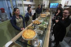 Visitors taste cakes at the 'FICO Eataly World', 'La Fabbrica Italiana Contadina' ('The Italian Farmer Factory') agri-food park in Bologna, Italy.