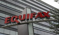This July 21, 2012, file photo shows signage at the corporate headquarters of Equifax Inc. in Atlanta
