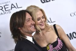Keith Urban eft, and Nicole Kidman attend the 2017 Glamour Women of the Year Awards at Kings Theatre on Monday, Nov. 13, 2017, in New York.