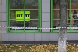 In this Oct. 27, 2017, file photo, Russian state-owned television station RT logo is seen at the window of the company's office in Moscow, Russia