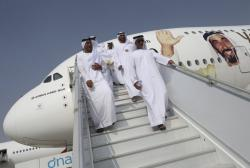 Emirati officials visit an Airbus A-380 decorated with an image of the late Sheikh Zayed bin Sultan Al Nahyan.