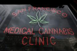 This Oct. 19, 2009 file photo shows a neon sign at the entrance to the San Francisco Medical Cannabis Clinic in San Francisco