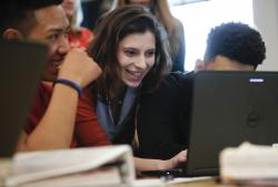 Sirio Chavez, left, and Anton Eiss, right, work with teacher Phoebe Sherman on the civics computer game iCivics during Sherman's 11th grade social studies class at Roosevelt High School's International Academy in Washington, Thursday, Nov. 16, 2017