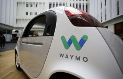 In this Tuesday, Dec. 13, 2016, file photo, the Waymo driverless car is displayed during a Google event in San Francisco