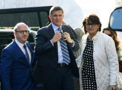Former Trump national security adviser Michael Flynn, center, arrives at federal court in Washington, Friday, Dec. 1, 2017.