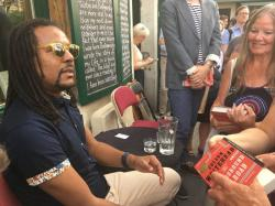 "Novelist Colson Whitehead speaks to fans after discussing his Pulitzer prize-winning book ""The Underground Railroad"" at the English-language bookstore Shakespeare and Company in Paris."
