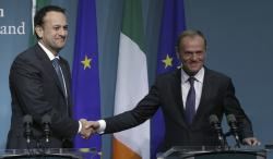 President of the European Council, Donald Tusk, right, shakes hands with Irish Prime Minister Leo Varadkar at a press conference at Government Buildings in Dublin to discuss preparations for the December European Council, Friday Dec. 1, 2017