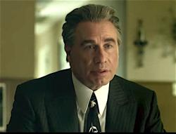 "John Travolta in the trailer for ""Gotti."""