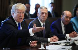 President Donald Trump with Secretary of Defense Jim Mattis, center and Secretary of Commerce Wilbur Ross, right, speaks during a cabinet meeting in the Cabinet Meeting Room of the White House in Washington, Wednesday, Dec. 6, 2017