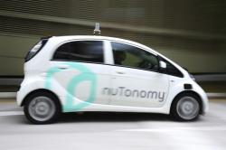 In this Wednesday, Aug. 24, 2016, file photo a nuTonomy autonomous vehicle is driven during its test drive in Singapore