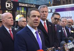 New York Gov. Andrew Cuomo speaks to members of the media after a pipe bomb strapped to a man went off in a New York City subway near Times Square.