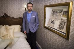 Bjorn Ulvaeus, former band member of the group ABBA, poses for photographers in a recreation of the Brighton hotel suite, where the group celebrated their 1974 Eurovision Song Contest victory.