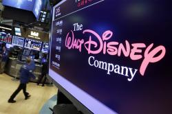 The Walt Disney Co. logo appears on a screen above the floor of the New York Stock Exchange