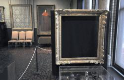 "In this March 11, 2010, file photo, empty frames from which thieves took ""Storm on the Sea of Galilee,"" left rear, by Rembrandt and ""The Concert,"" right foreground, by Vermeer, remain on display at the Isabella Stewart Gardner Museum in Boston"