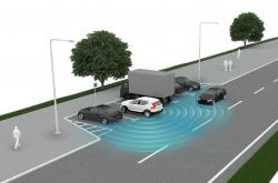 This graphic provided by Volvo shows how a rear cross-traffic system spots oncoming vehicles