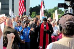 Rev. William Barber II has been at the forefront of the fight for equality and social justice on the national stage level. Here he is seen speaking to participants in a Moral Monday initative at the North Carolina State Capitol in Raleigh, N.C.