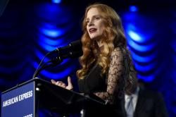 "Jessica Chastain accepts the chairman's award for ""Molly's Game"" at the 29th annual Palm Springs International Film Festival."