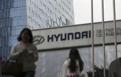 In this Oct. 26, 2017, file photo, the logo of Hyundai Motor Co. is displayed at the automaker's showroom in Seoul, South Korea