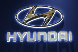 This Thursday, Feb. 11, 2016, file photo shows the Hyundai logo on display at the Pittsburgh International Auto Show in Pittsburgh