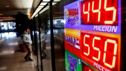 A sign at a store in Atlanta displays the Powerball and Mega Millions jackpots on Thursday, (David Goldman / Associated Press)