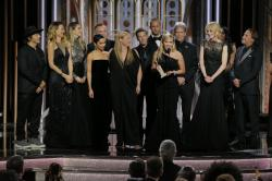 "Reese Witherspoon, foreground, with the cast and crew of ""Big Little Lies,"" as she accepts the award for best limited series or motion picture made for TV at the 75th Annual Golden Globe Awards."