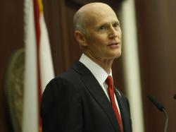 Florida Gov. Rick Scott delivers his State of the State Address in the House chambers on the opening day of the legislative session, Tuesday, Jan. 9, 2018, in Tallahassee, Fla.